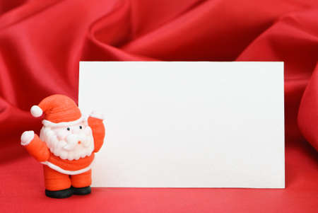Christmas placard with Santa for table setting with red satin background Stock Photo - 4000573