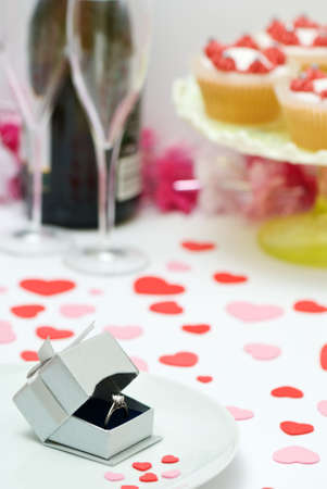 Valentine table setting with engagement ring ready for proposal photo