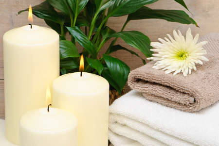 Calm and relaxing spa setting with lit candles and towels Stock Photo - 4000595