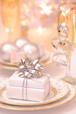 Table setting with gifts for celebration photo