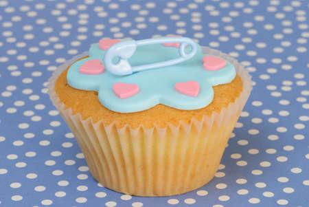 its a boy: Its a boy birth or christening cupcake on blue spotty background