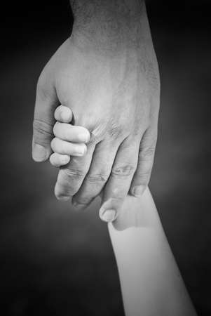 parents baby: Classic holding hands image in back & white