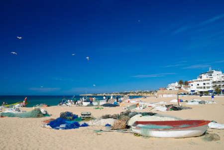 Busy working beach at Arma��o de P�ra Portugal photo