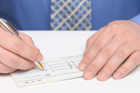 Business man writing a cheque photo