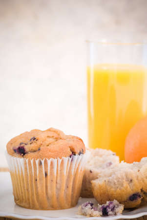 Blueberry muffins for breakfast with orange juice photo