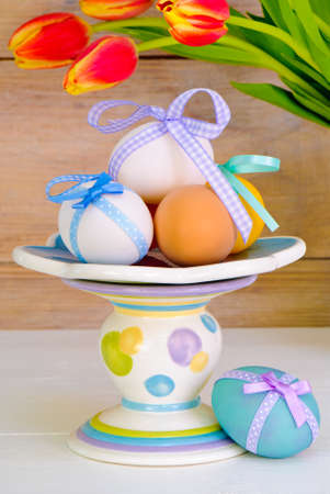 Festive Easter eggs with tulips in the background photo