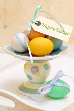 Colourful Easter eggs arrangement on wooden tray photo