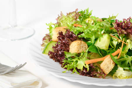 Healthy fresh green leaf salad in white background setting photo