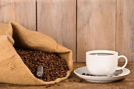 Cup of coffee with sack of coffee beans Stock Photo - 4305752