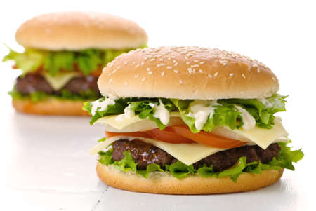 hamburgers: Two large burgers on a white background