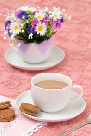 Table set for afternoon tea and biscuits  photo