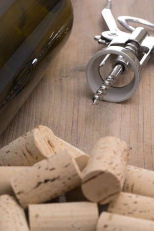 Wine composition with corks and corkscrew, focus on tip of corkscrew Stock Photo - 4434151