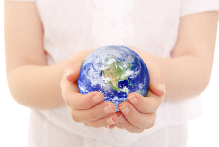 cradling: Young child cradling the Earth in her hands