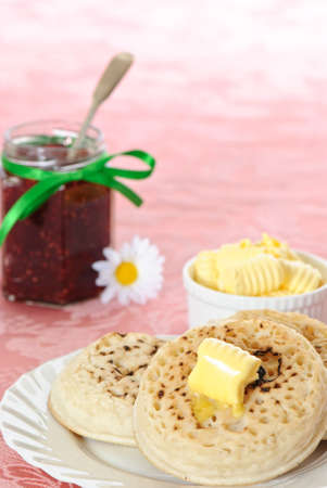 Hot buttered crumpets with jam Stock Photo - 4492247