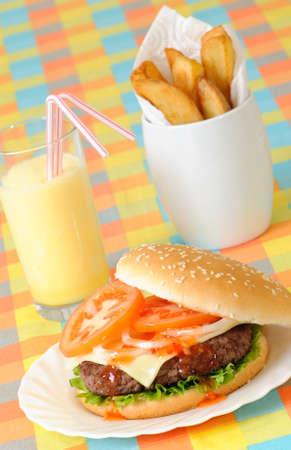 un healthy: Burger, fries & milkshake in American diner setting