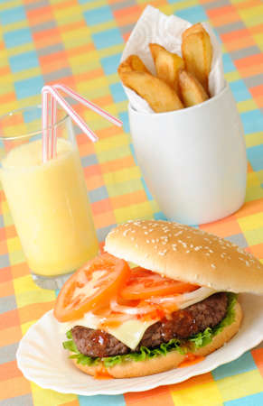 Burger, fries & milkshake in American diner setting