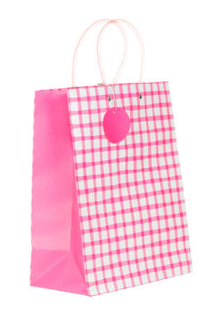 Pink gift bag isolated on white background photo