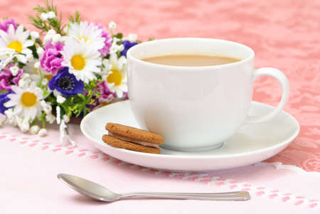 Afternoon tea & biscuit with flowers in background photo