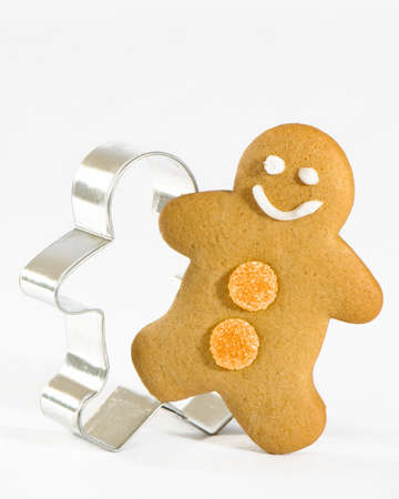 Gingerbread man stepping out of the mould photo