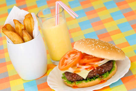 Open burger and fries in American diner setting with milkshake photo