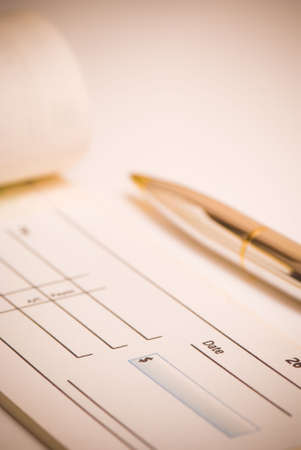 Blank cheque with pen ready to pay bills photo
