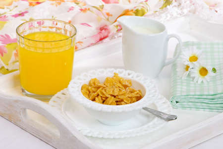 Tray with breakfast cereal in pretty heart bowls with orange juice photo