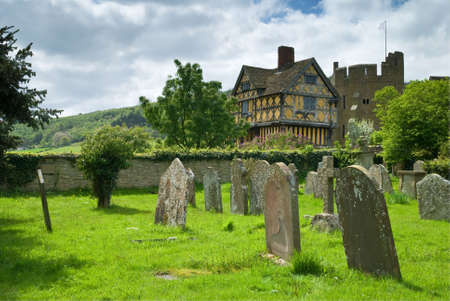 churchyard: Stokesay Castle, a fortified manor house from the 13th century, view from adjacent churchyard