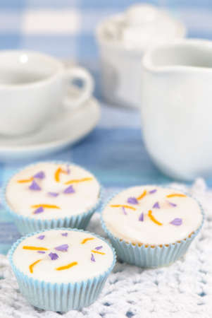 zest: Afternoon tea party with cupcakes decorated with orange zest and lavender Stock Photo