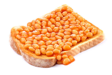 Baked beans on toast on white background Stock Photo