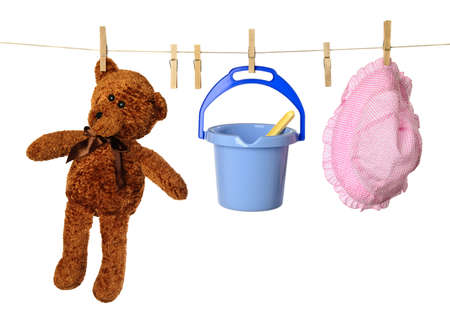 kiddies: Washing line with childs holiday toys and teddy bear