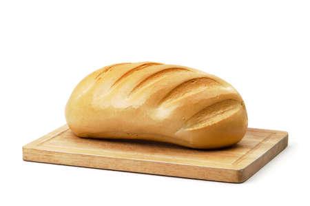 crusty: Crusty white loaf of bread on rustic wooden board