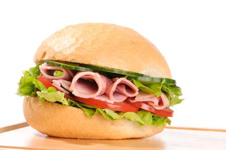crusty: Ham salad crusty white roll on wooden board Stock Photo