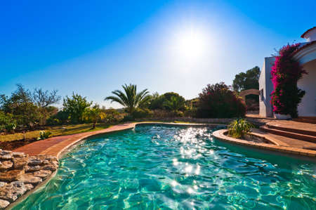 Luxury swimming pool sparkling in the evening sunshine Stock Photo - 5033816