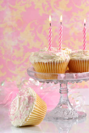 Pink Birthday cakes on glass comport with marshmallows around outside of dish Stock Photo - 5033822