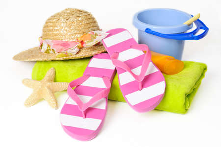bucket and spade: Bucket and spade with flip flops and other beach items