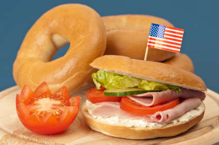 Cream cheese and ham bagels with salad and tomato garnish - American flag in front bagel Stock Photo - 5084492