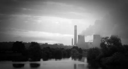 acid rain: Black and white landscape of power station reflected in water