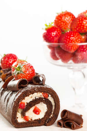 Chocolate cake with comport of fresh strawberries in background Stock Photo - 5099230