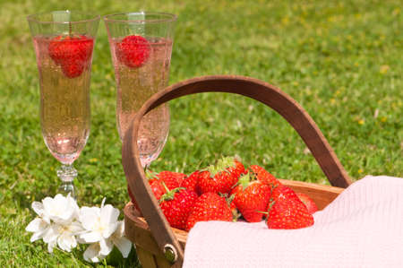 Two glasses of pink champagne and strawberries al fresco
