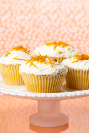 zest: Comport of cupcakes decorated with butter cream and orange zest