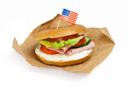 bagel: New York bagel with ham and cream cheese filling with American flag Stock Photo