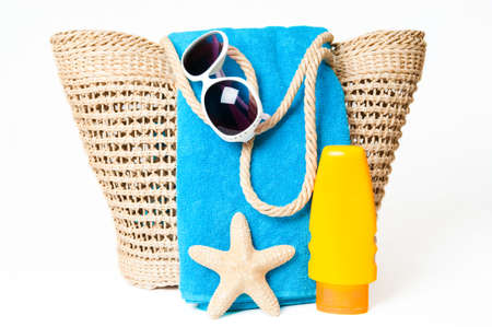 echinoderm: Items ready for a day at the beach with towel, suntan lotion and sunglasses