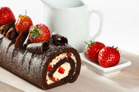 Chocolate cake with strawberries and cream on wooden board Stock Photo - 5146357