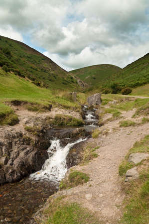 mill valley: Running stream through Carding Mill Valley, part of the Long Mynd, Shropshire, UK Stock Photo