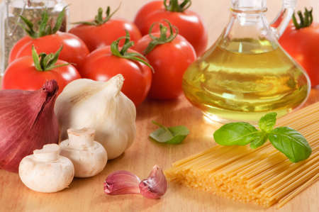 Italian ingredients for spaghetti with tomatoes, garlic, mushrooms, and herbs photo