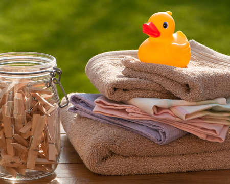 laundered: Freshly laundered towels with clothes pegs and rubber duck