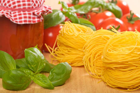 bolognaise: Jar of bolognaise sauce with pasta, tomatoes and basil herbs