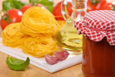 Bolognaise sauce in a jar with pasta, tomatoes and basil Stock Photo - 5396120