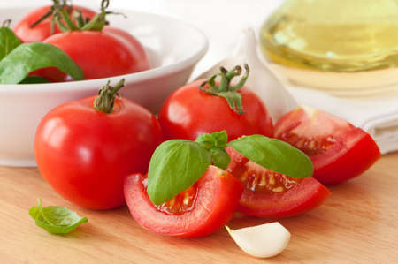 Juicy ripe organic tomatoes with garlic and olive oil Stock Photo - 5430498