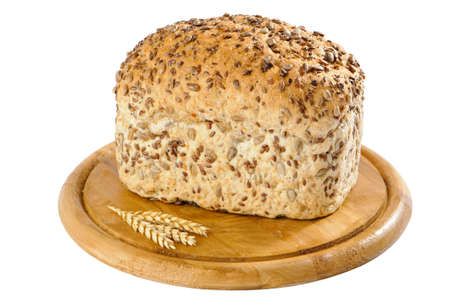 unsliced: Wholemeal bread with sunflower seeds on rustic board